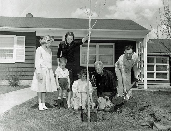 Waldo Luebben with Family Planting a Tree