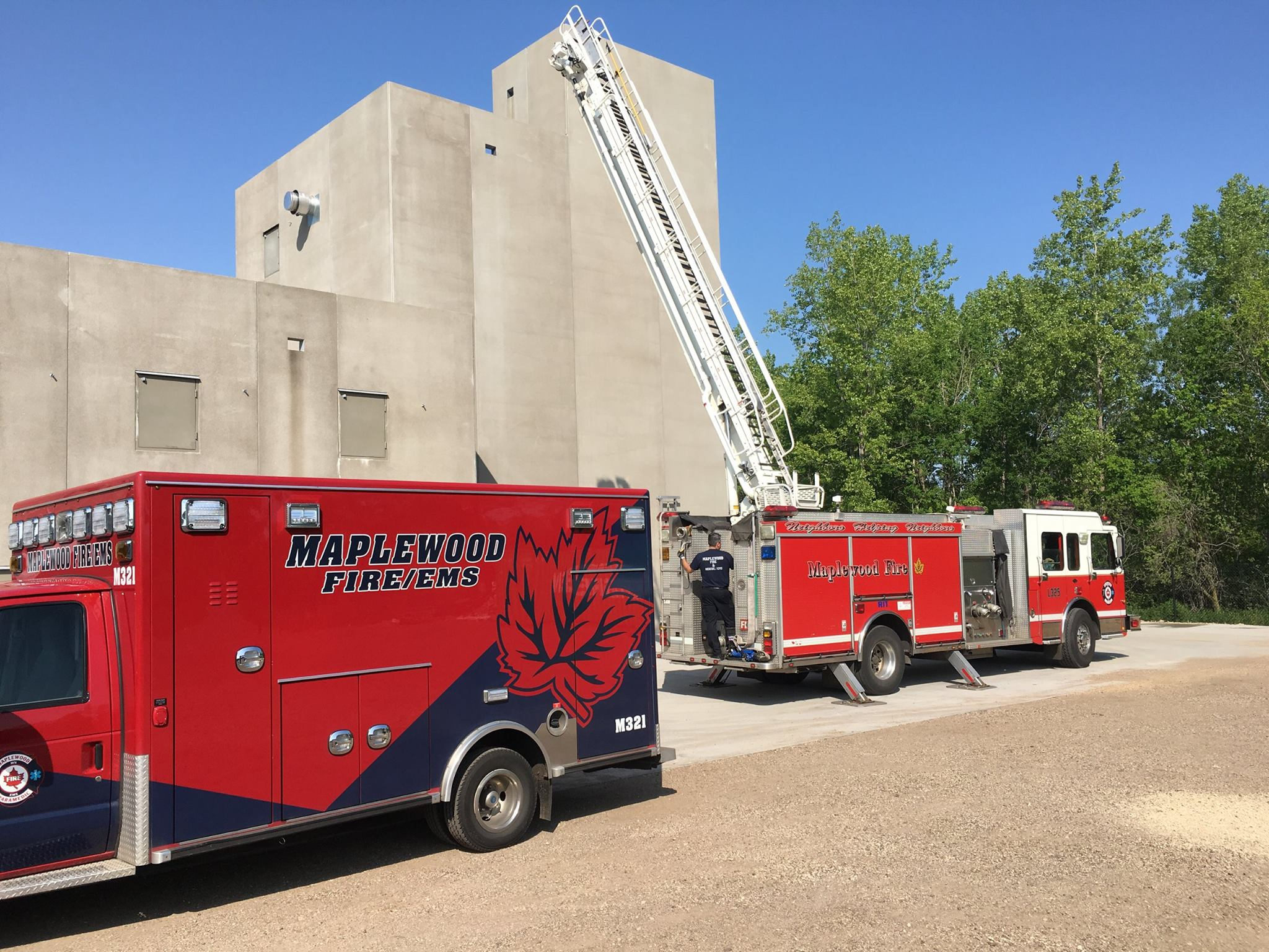 Vehicles in front of Burn Building training