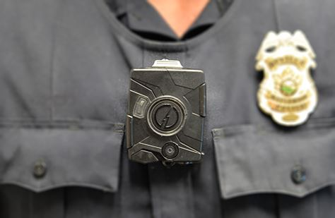 Body camera worn on the chest of a police officer