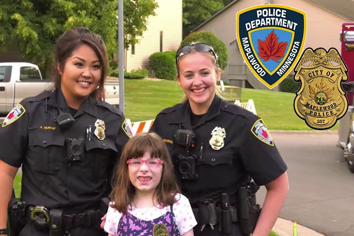 Officers with girl posing for a picture