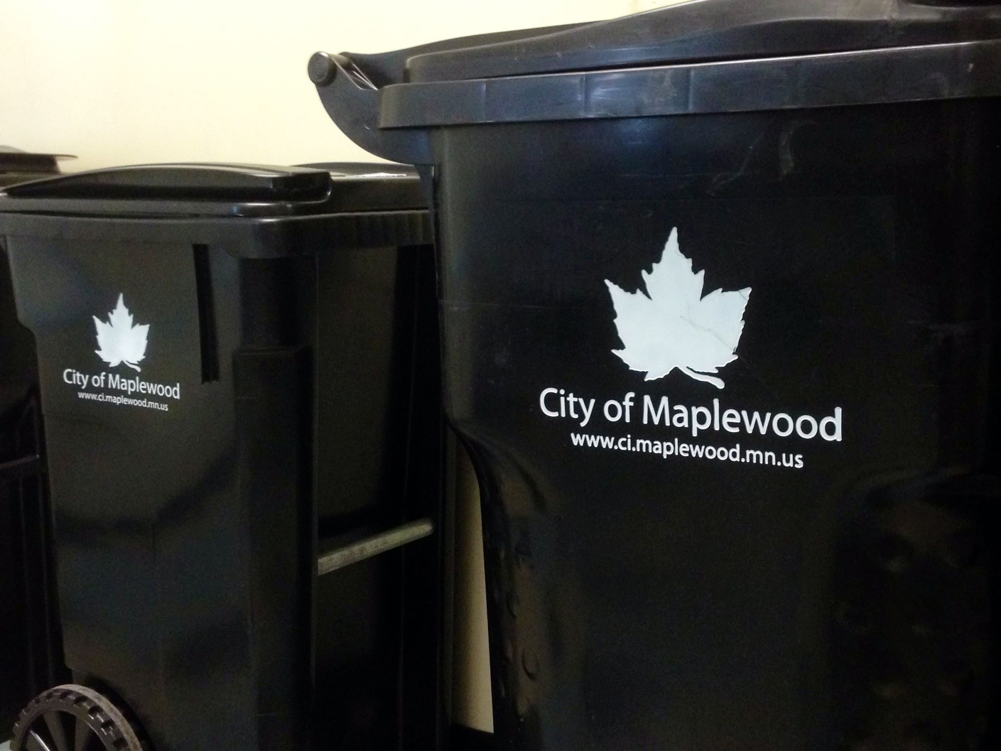 Black City of Maplewood trash totes