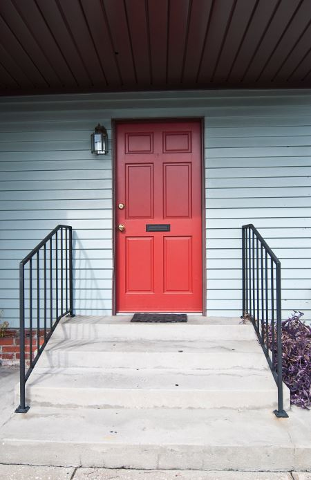 Front stoop with red door