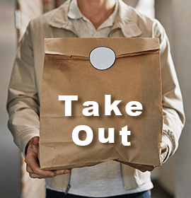 Person carrying a brown takeout bag